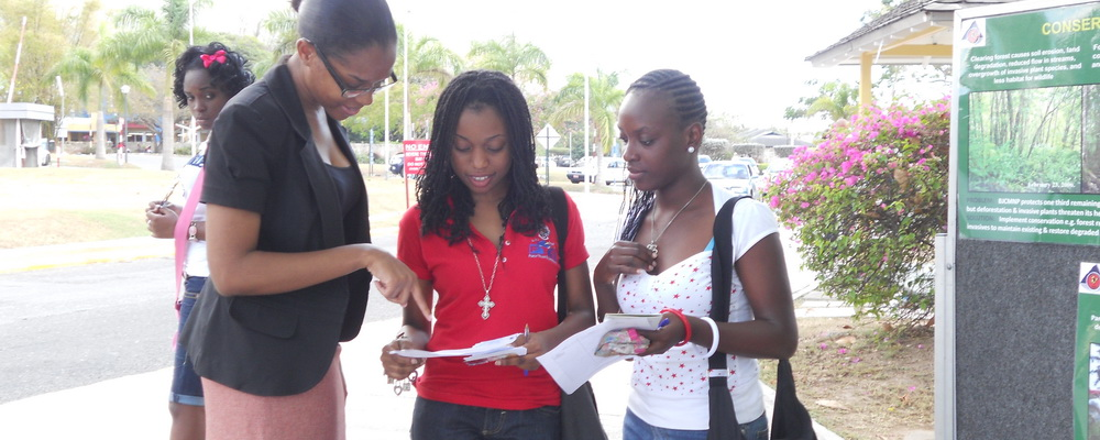 Stacy-Ann Robinson explains a point to UWI students