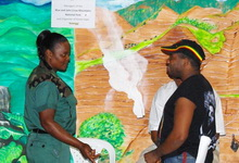 Ranger Dawes explains BJCMNP exhibits at Green Expo